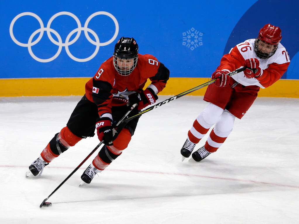 . Jennifer Wakefield (9), of Canada, controls the puck against Russian athlete Yekaterina Nikolayeva (76) during the third period of the preliminary round of the women\'s hockey game at the 2018 Winter Olympics in Gangneung, South Korea, Sunday, Feb. 11, 2018. (AP Photo/Frank Franklin II)