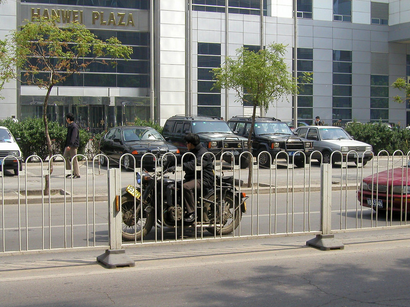 these type of road partitions, to stop people for crossing were common - Beiijng 2002 Beijing 2007