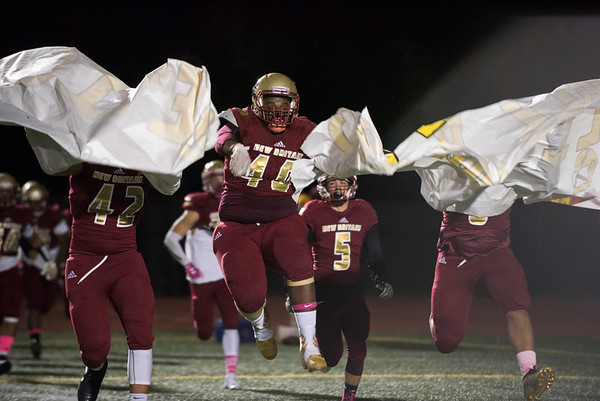 10/11/19 Wesley Bunnell | StaffrrNew Britain football vs Hall at Veterans Stadium in New Britain on Friday night. Orlando Perez (40) leads the team onto the field.