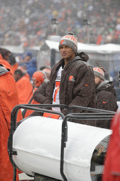 . Cleveland Browns quarterback DeShone Kizer (7) watches against the Chicago Bears in the first half of an NFL football game in Chicago, Sunday, Dec. 24, 2017. (AP Photo/Charles Rex Arbogast)