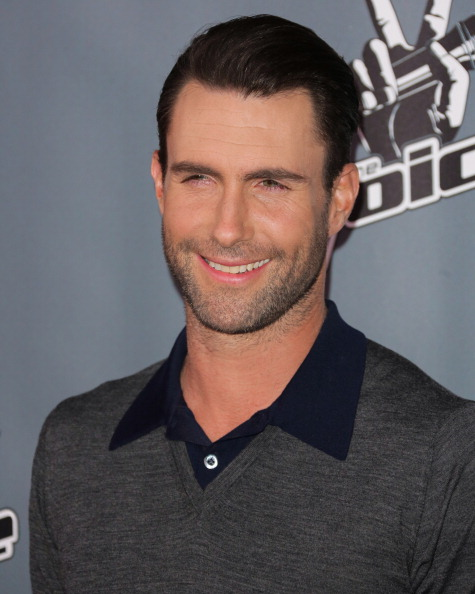 ". UNIVERSAL CITY, CA - NOVEMBER 07:  Recording Artist Adam Levine attends the ""The Voice\"" season 5 Top 12 red carpet event at Universal Studios Hollywood on November 7, 2013 in Universal City, California.  (Photo by Paul Archuleta/FilmMagic)"