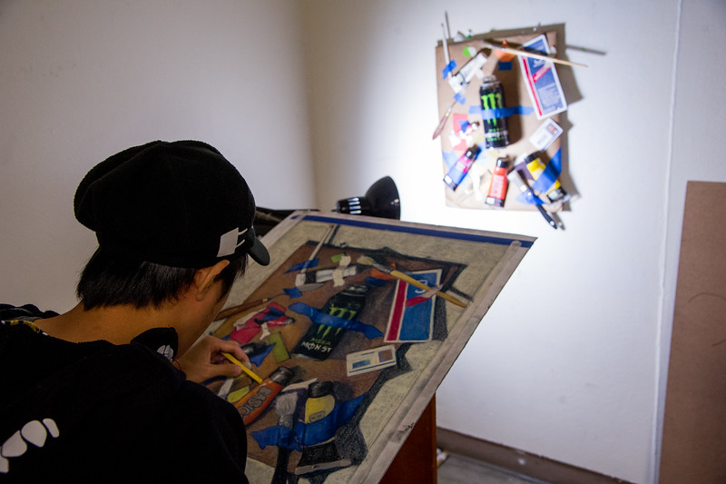 Student Charles Chong works to complete a project for his Drawing 3 class.