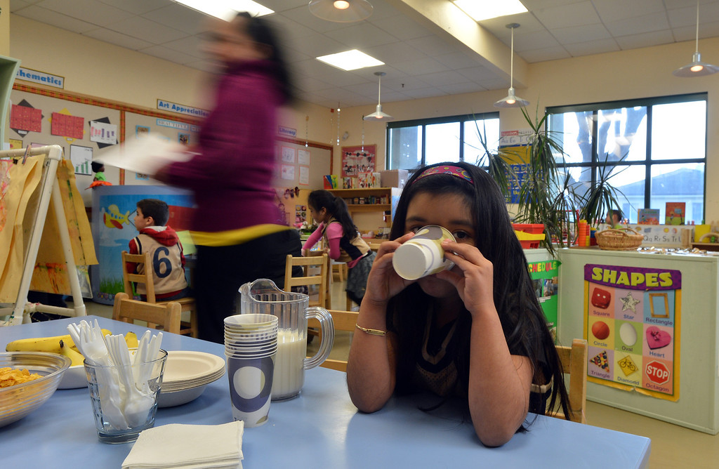 . Arelee Rodriguez, 5, has a glass of milk at the George Miller III Children\'s Center in Richmond, Calif. on Wednesday, Feb. 27, 2013. Funding for the daycare center could be jeopardized by automatic spending cuts by the federal government. (Kristopher Skinner/Staff)