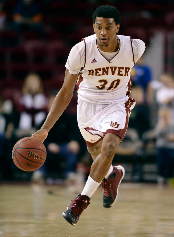 . DENVER, CO. - FEBRUARY 8, 2014: Pioneers junior guard Cam Griffin brought the ball down the court in the second half. The University of Denver defeated South Dakota 75-67 Saturday evening, February 8, 2014. Photo By Karl Gehring/The Denver Post