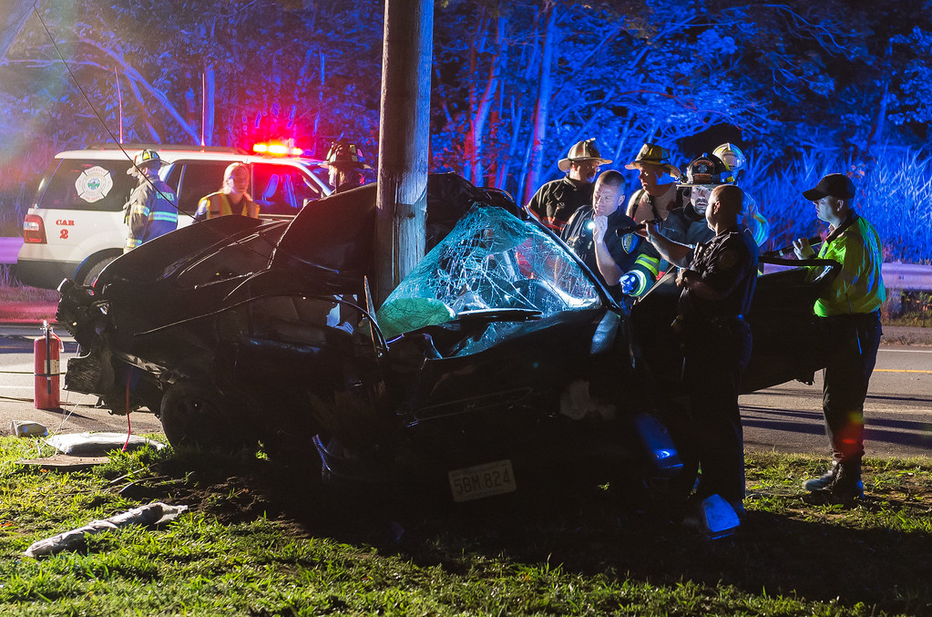 . Gardner Police, Fire and State Police examine a car that slammed into a utility pole on East Broadway at Minott Rd in Gardner killing the driver. SENTINEL&ENTERPRISE/ Jim Marabello