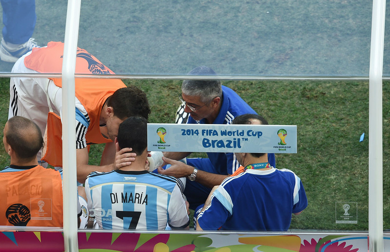. Argentina\'s midfielder Angel Di Maria (C, number 7) is given aid after being substituted during a quarter-final football match between Argentina and Belgium at the Mane Garrincha National Stadium in Brasilia during the 2014 FIFA World Cup on July 5, 2014.  (EVARISTO SA/AFP/Getty Images)