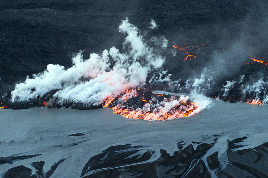 . An aerial picture taken on September 14, 2014 shows lava and smoke flowing out of the Bardarbunga volcano in southeast Iceland. The Bardarbunga volcano system has been rocked by hundreds of tremors daily since mid-August, prompting fears the volcano could explode. Bardarbunga, at 2,000 metres (6,500 feet), is Iceland\'s second-highest peak and is located under Europe\'s largest glacier, Vatnajoekull. BERNARD MERIC/AFP/Getty Images