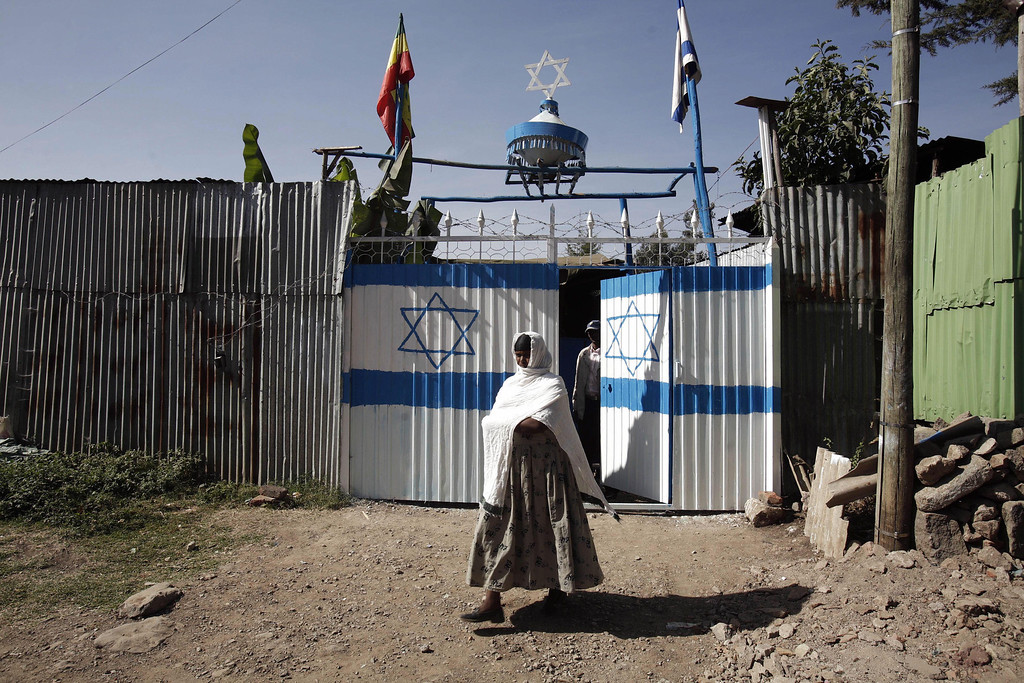 . Addis Ababa, ETHIOPIA: An Ethiopian Jewish woman leaves a synagogue after attending a morning prayer service 16 March 2007 in Addis Ababa, Ethiopia. Thousands of Ethiopian Jews have left their villages for Addis Abeba, hoping to be able to emigrate to Israel. JOSE CENDON/AFP/Getty Images