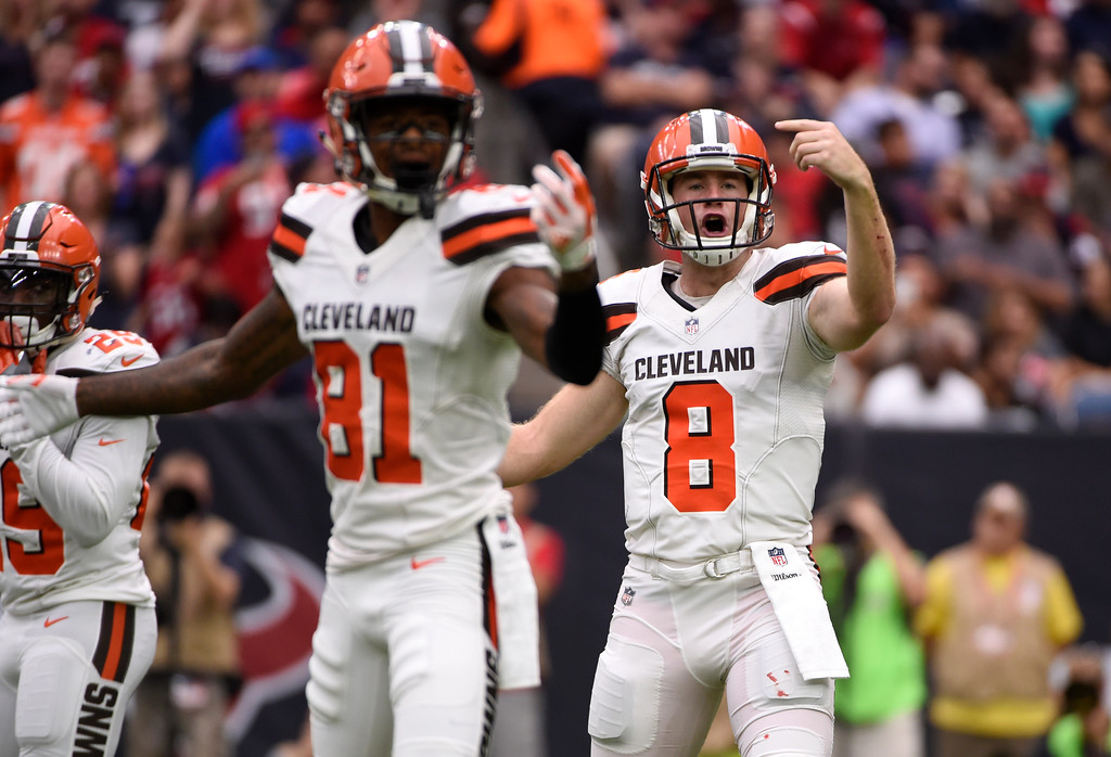 . Cleveland Browns\' Rashard Higgins (81) and Kevin Hogan (8) signal to the sideline in the first half of an NFL football game against the Houston Texans on Sunday, Oct. 15, 2017, in Houston. (AP Photo/Eric Christian Smith)