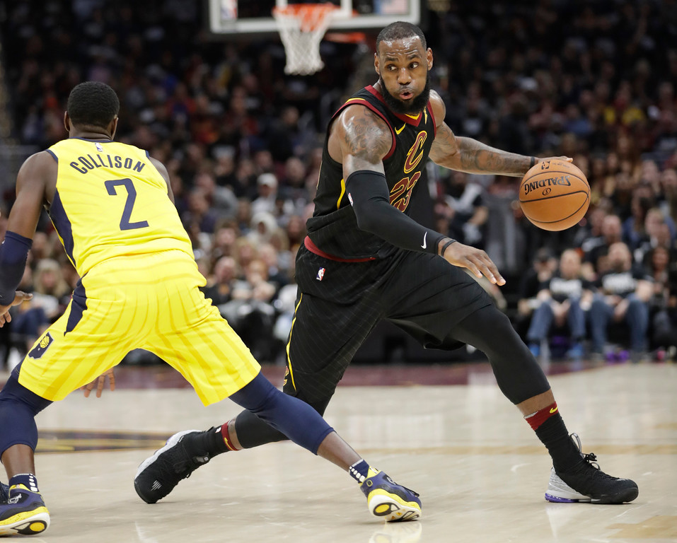 . Cleveland Cavaliers\' LeBron James (23) drives around Indiana Pacers\' Darren Collison (2) in the first half of Game 1 of an NBA basketball first-round playoff series, Sunday, April 15, 2018, in Cleveland. (AP Photo/Tony Dejak)