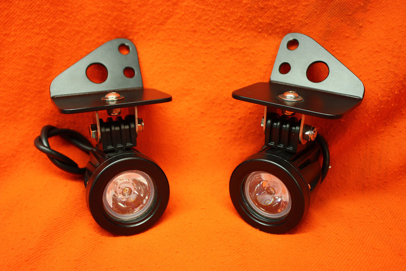LED aux lights model specific for the second generation KLR650 and Dr650. The mounts are hand fabricated and powdercoated satin black. They mount to the lower triple clamp bolts. The lights are a high quality Cree 10 watt LED, 1000 lumen, 30 degree spot lamps. Cost is $160.00 a pair. Contact me at dakotabeemer@hotmail.com