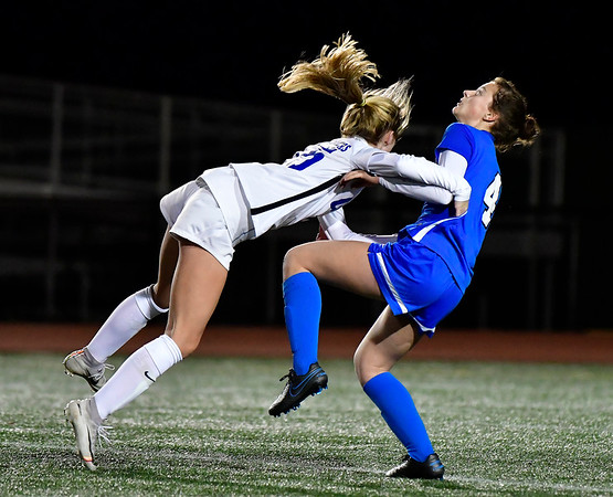 11/23/2019 Mike Orazzi | StaffrSouthington High Schools Jessica Carr (4) and Glastonbury's Sophia Haussmann (15) during the Class LL Girls State Soccer Tournament at Veterans Stadium in New Britain Saturday evening. Glastonbury won 1-0. r