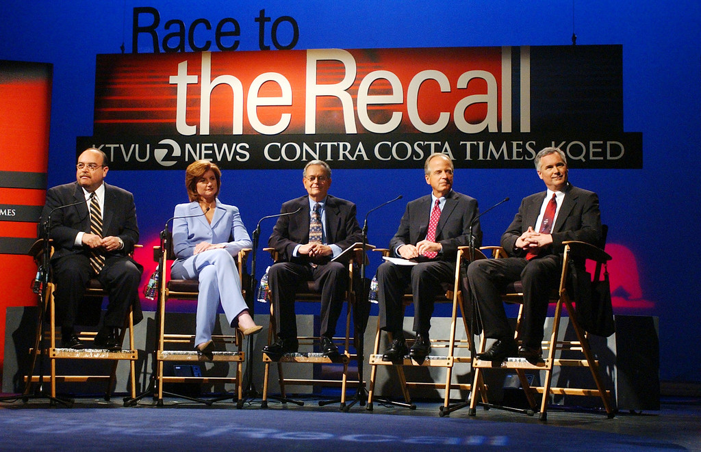 . WALNUT CREEK, CA - SEPTEMBER 3:  Five of the 135 candidates for California governor in the October 7 recall election are shown on stage prior to a debate at the Dean Lesher Regional Center for the Arts September 3, 2003 in Walnut Creek, California. Gov. Gray Davis appeared prior to the debate. The candidates are: (L-R) Lt. Gov. Cruz Bustamante, Arianna Huffington, Peter Camejo, Peter Ueberroth and Tom McClintock. Republican front-runner Arnold Schwarzenegger declined to attend.  (Photo by Karl Mondon-Pool/Getty Images)