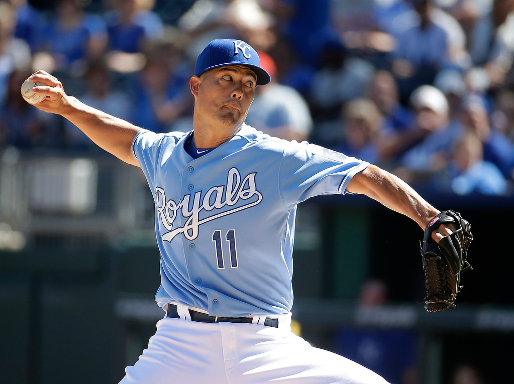. Kansas City Royals starting pitcher Jeremy Guthrie throws during the first inning of a baseball game against the Detroit Tigers, Sunday, Sept. 21, 2014, in Kansas City, Mo. (AP Photo/Charlie Riedel)