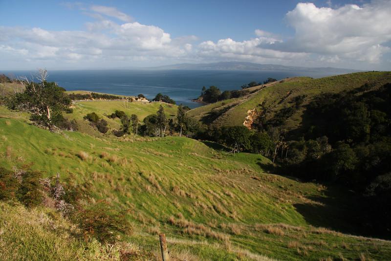 New Zealand: The Coromandel Peninsula Rugged green hills meet the Pacific Ocean on the Coromandel Peninsula in New Zealand.