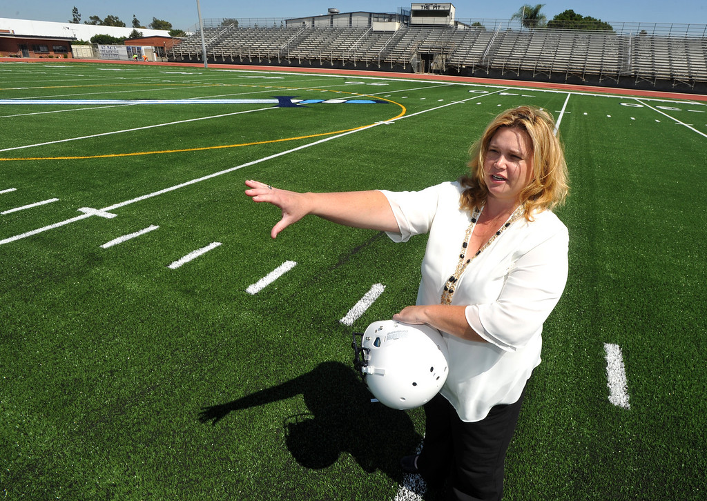 . Principal Kate Aceves talks about their newly completed Astroturf football field at St. Paul High School in Santa Fe Springs on Friday August 9, 2013. St. Paul officials, students, and alumnae will dedicate the school\'s new football field and volleyball and basketball floors on Saturday.