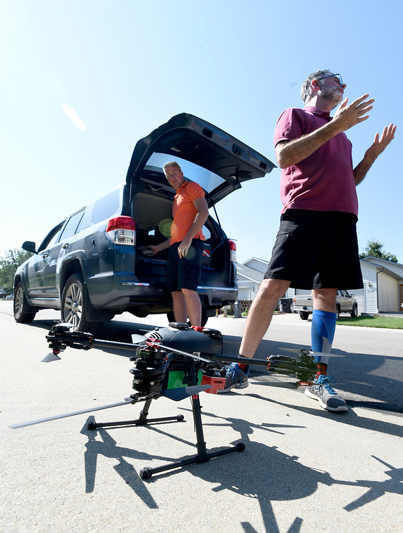 . LONGMONT, CO - AUGUST 9: Tim Haynie, left, and Dan Staley, both of Arbor Drone, are about ready for liftoff in Longmont.  Arbor Drone LLC and Spectrabotics LLC,  collected data using drone flights over northwest Longmont on August 9, 2018, to study and monitor trees affected by Emerald Ash Borer (EAB).  Longmont will be one of the last EAB detection flights for 2018 for the team. Drone flights in urban areas to study tree pests have never been conducted at this scale. (Photo by Cliff Grassmick/Staff Photographer)