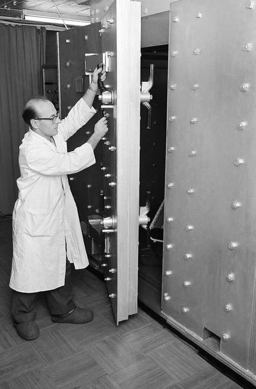 . The Max-Planck-institute for Biophysics installed the first Gamma-Ray spectrometer in Germany. The meter based on American developments measures and analyzes the amount, kind and exact location of radioactive substances in the human body. The Gamma-Ray spectrometer was installed in a steel chamber ten feet below ground in order to prevent cosmic rays from interfering with the measurements. Meter and installation cost about 60,000 dollars. Electronics engineer Gerhard Heigwer of the Max-Planck-Institute at the controls of the Gamma-Ray spectrometer outside the steel chamber in Frankfurt, Germany on Jan. 24, 1961. (AP Photo/Strumpf)