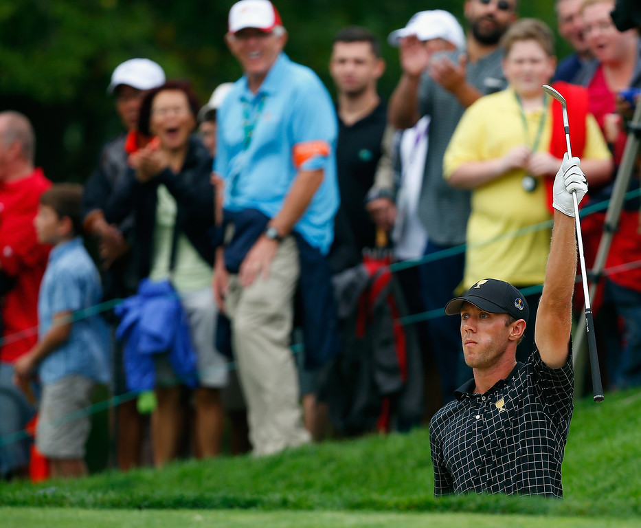 . Graham DeLaet of Canada and the International Team celebrates after making a birdie on the 18th hole during the Day Four Singles Matches at the Muirfield Village Golf Club on October 6, 2013  in Dublin, Ohio.  (Photo by Matt Sullivan/Getty Images)