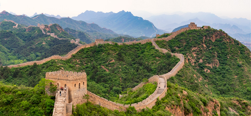 Great Wall of China, weaving across ridges and mountains as far as you can see.