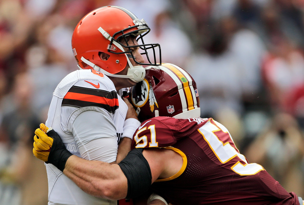 . Cleveland Browns quarterback Cody Kessler (6) is hit by Washington Redskins inside linebacker Will Compton (51) after he threw a touchdown pass during the first half of an NFL football game Sunday, Oct. 2, 2016, in Landover, Md. (AP Photo/Mark Tenally)
