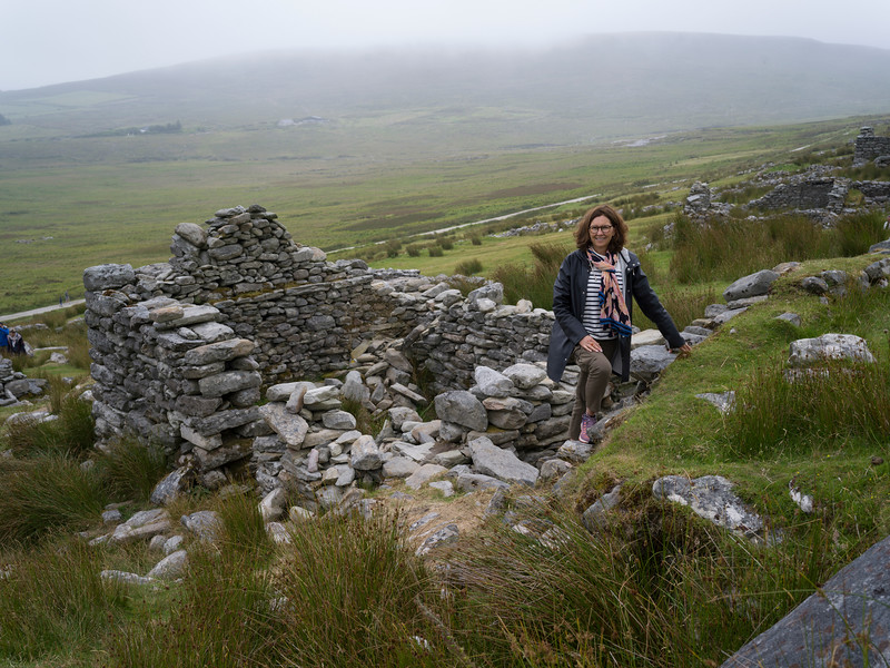 Women standing on the ruins of deserted village, Achill Island, County Mayo, Ireland