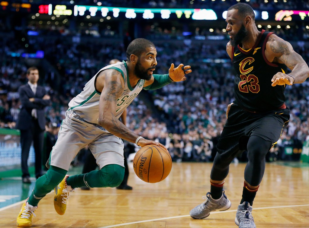 . Boston Celtics\' Kyrie Irving drives past Cleveland Cavaliers\' LeBron James (23) during the first quarter of an NBA basketball game in Boston, Sunday, Feb. 11, 2018. (AP Photo/Michael Dwyer)