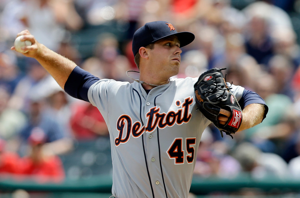 . Detroit Tigers starting pitcher Buck Farmer delivers in the first inning of a baseball game against the Cleveland Indians, Wednesday, June 24, 2015, in Cleveland. (AP Photo/Tony Dejak)