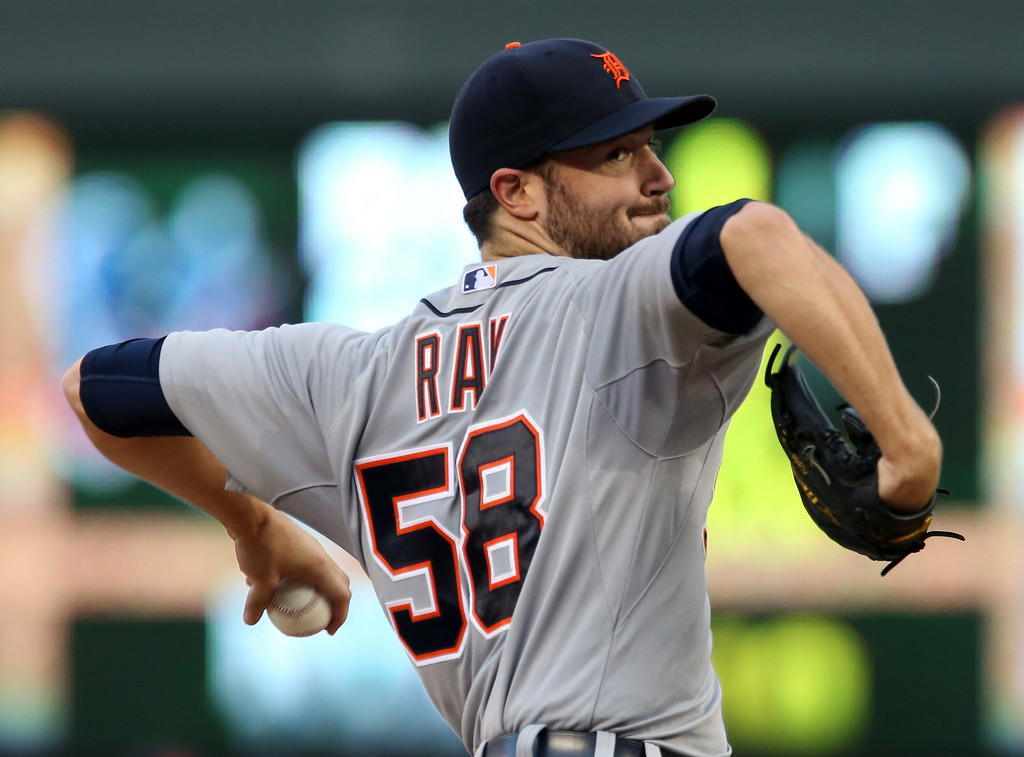 . Detroit Tigers starting pitcher Robbie Ray throws against the Minnesota Twinsin the first inning of a baseball game, Friday, Aug. 22, 2014, in Minneapolis. (AP Photo/Jim Mone)