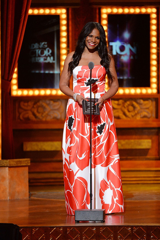 ". Audra McDonald accepts the award for Best Performance by an Actress in a Leading Role in a Play for ?""Lady Day\""? onstage during the 68th Annual Tony Awards at Radio City Music Hall on June 8, 2014 in New York City.  (Photo by Theo Wargo/Getty Images for Tony Awards Productions)"