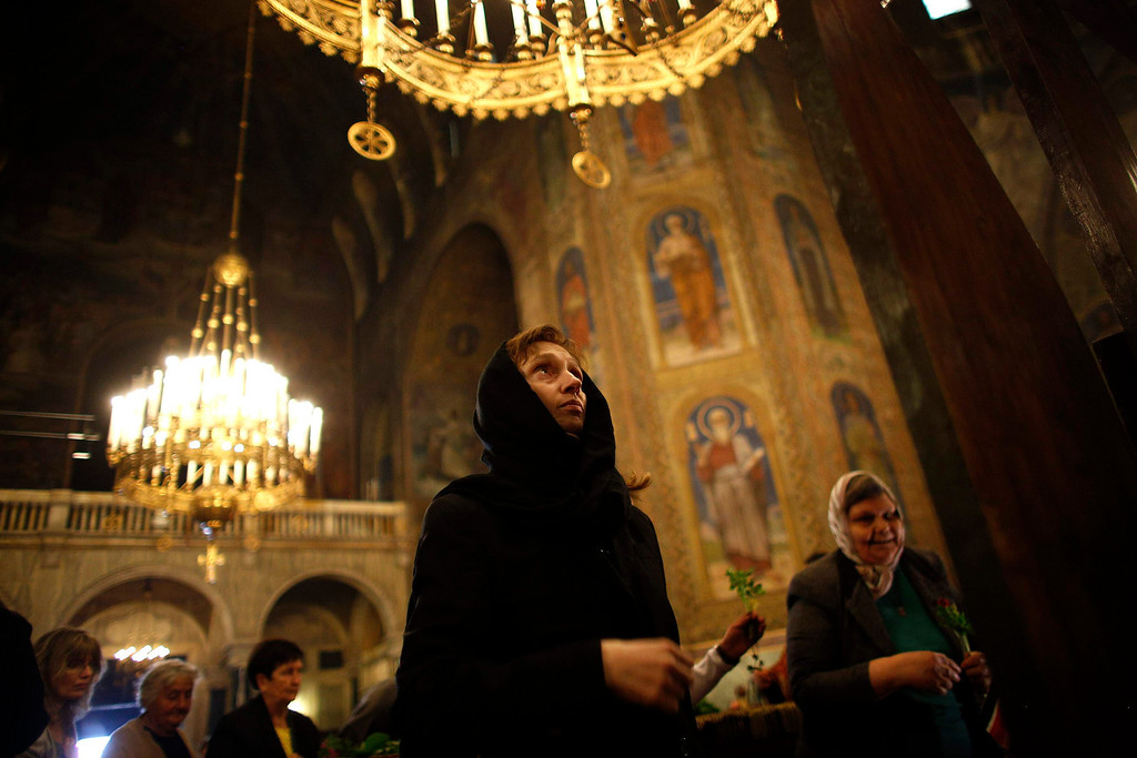 """. A worshipper looks at a wooden cross during the Good Friday mass at \""""Alexander Nevski\"""" cathedral in Sofia May 3, 2013. Bulgaria and other Eastern Orthodox countries celebrate Easter this weekend.       REUTERS/Stoyan Nenov"""