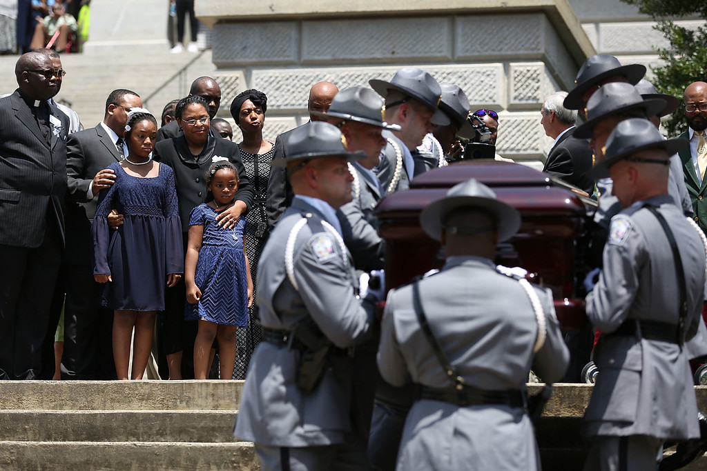 . As lawmakers, family and friends look on, the South Carolina Highway Patrol Honor Guard carry the coffin of church pastor and South Carolina State Sen. Clementa Pinckney to lie in repose at the Statehouse Rotunda on June 24, 2015 in Columbia, South Carolina. Pinckney was one of nine people killed during a Bible study inside Emanuel AME church in Charleston. U.S. President Barack Obama and Vice President Joe Biden are expected to attend the funeral which is set for Friday June 26 at the TD Arena.  (Photo by Joe Raedle/Getty Images)