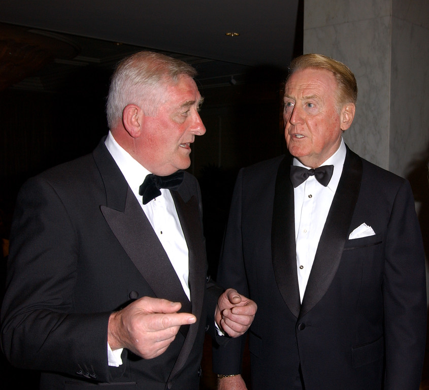 . Sportscaster Vin Scully (R) converses with the former Mayor of Dublin at the American Ireland Fund Gala April 17, 2002 in Los Angeles, CA. (Photo by Sebastian Artz/Getty Images)