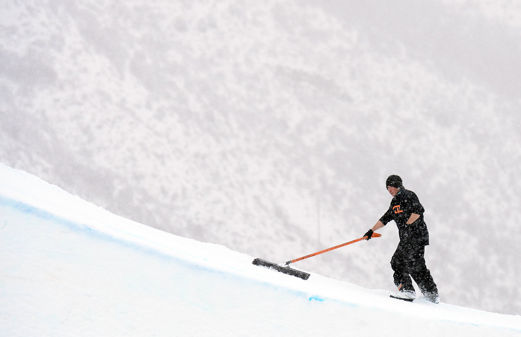 . VAIL, CO. - MARCH 1: Ground crew takes care of the jump during the men\'s slopestyle final of Burton U.S. Open. March 1, 2013. Vail, Colorado. (Photo By Hyoung Chang/The Denver Post)
