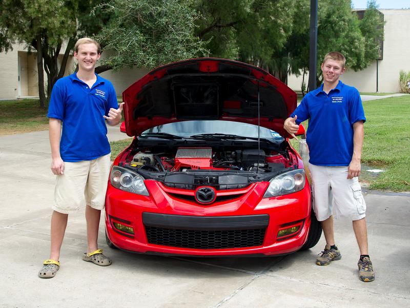 Students Logan Kerschbaum(left) and Nathan Jordan look to gain more members for the Car Club.