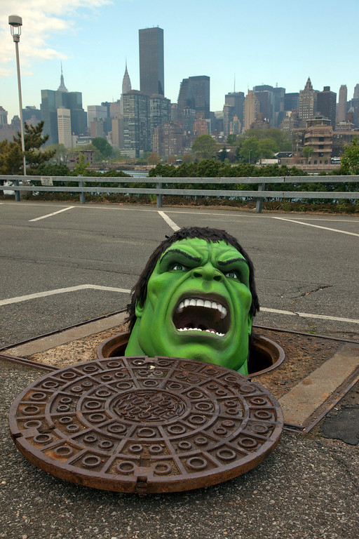. The Hulk from Madame Tussauds New York peers out of a manhole at the Con Ed Learning Center in Queens, New York on Thursday, April 19, 2012. The interactive Marvel Super Heroes Experience opens at Madame Tussauds New York on Thursday, April 26. Photo taken by newscast for Madame Tussauds.(Jim Sulley/newscast)