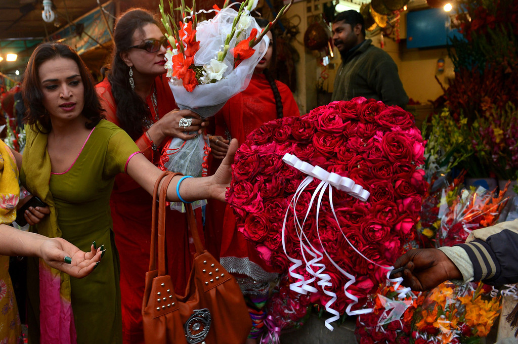 . A Pakistani transgender selects a Valentine gift at a shop in Lahore on February 14, 2014. At least three students were wounded in a clash at a university in the northwestern Pakistani city of Peshawar, following a dispute over Valentine\'s Day celebrations in the deeply Muslim country, police said. AFP PHOTO/Arif Ali/AFP/Getty Images