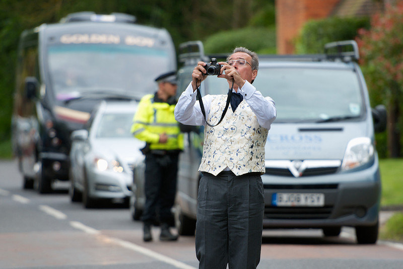 The well-dressed photographer
