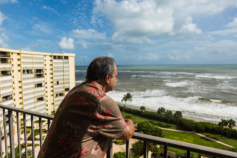 Gary Freedman looks out from his 12th story balcony at the Ocean Trail Condominium on Wednesday, October 12, 2016. The Freedman's chose to stay in their condo during Hurricane Matthew after an evacuation order was issued. (Joseph Forzano / The Palm Beach Post)