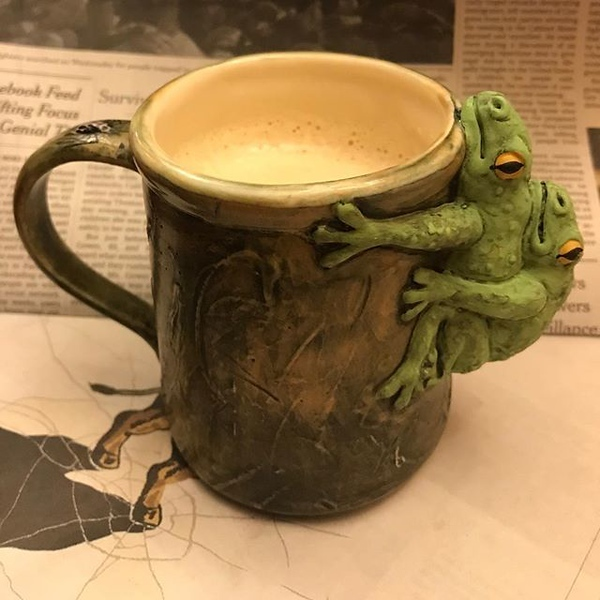 A latte and the @nytimes can really put frogs in the right mood @jennyonthespot #jotsmugoftheday