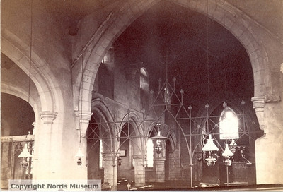 "PH/SPALD/18: St James's Church, Spaldwick:  an interior view looking west to the south side of the nave, showing part of the south aisle, lamps and wrought iron screen (has written on the back ""Int. S.W. from chancel"";  and written across the top ""548.  SPALDWICK. HUNTS. Int. S.W. 1897"").