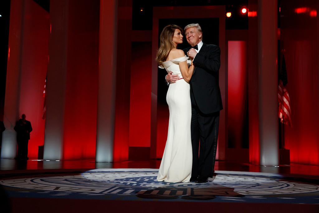 . President Donald Trump dances with first lady Melania Trump at the Liberty Ball, Friday, Jan. 20, 2017, in Washington. (AP Photo/Evan Vucci)