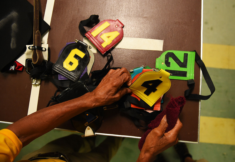 . Numbers are prepared prior to the 139th running of the Preakness Stakes at Pimlico Race Course on May 17, 2014 in Baltimore, Maryland.  (Photo by Patrick Smith/Getty Images)