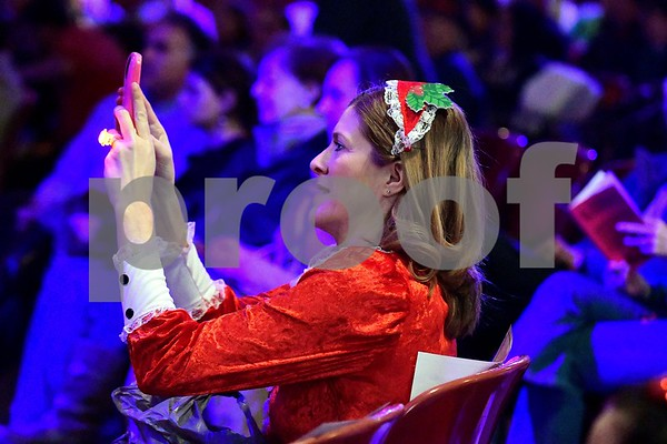 12/17/2016 Mike Orazzi | Staff Leona Clerkin photographs the performers during the 2nd Annual Tuba Christmas at Trinity-On-Main in downtown New Britain Saturday.