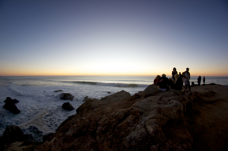 Visitors gather to watch the sunset