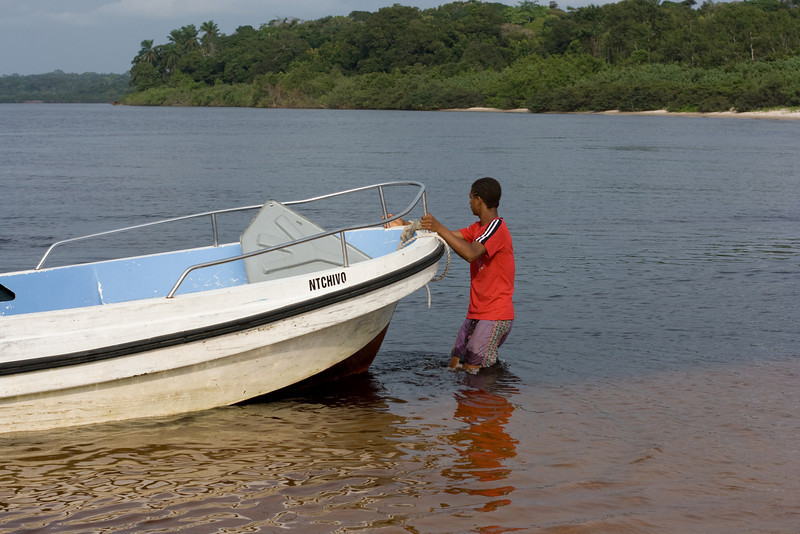 Pulling our boat ashore so we can explore the beach.