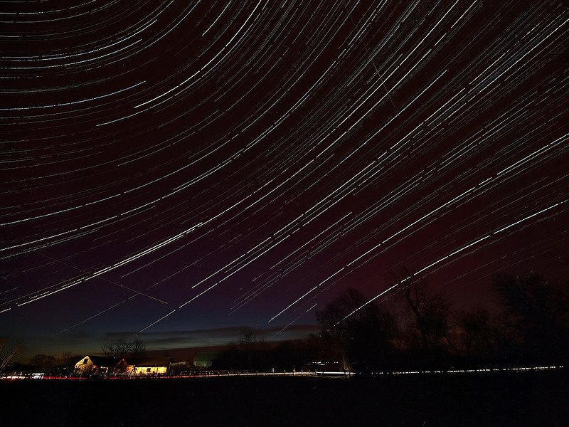 Startrail with a couple of Leonids captured on the evening/morning of 16th/17th November 2009. Height of the Leonid meteor shower and disappointed only to capture a couple. Set up Olympus E3 with 7-14mm lens on tripod, 15s exposure, F4.0 and captured continuous from 2100hrs on 16th through till 0700hrs on 17th. 9 hrs of earths motion, 2000 images put together in startrails software. Nice to capture the opposite curvature of the trails above and below the celestial equator.