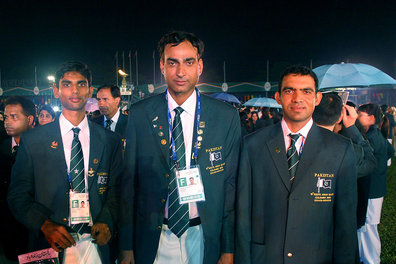 Then it started to rain.  Zohaib, Arshad Islam and Zaheer getting wet.
