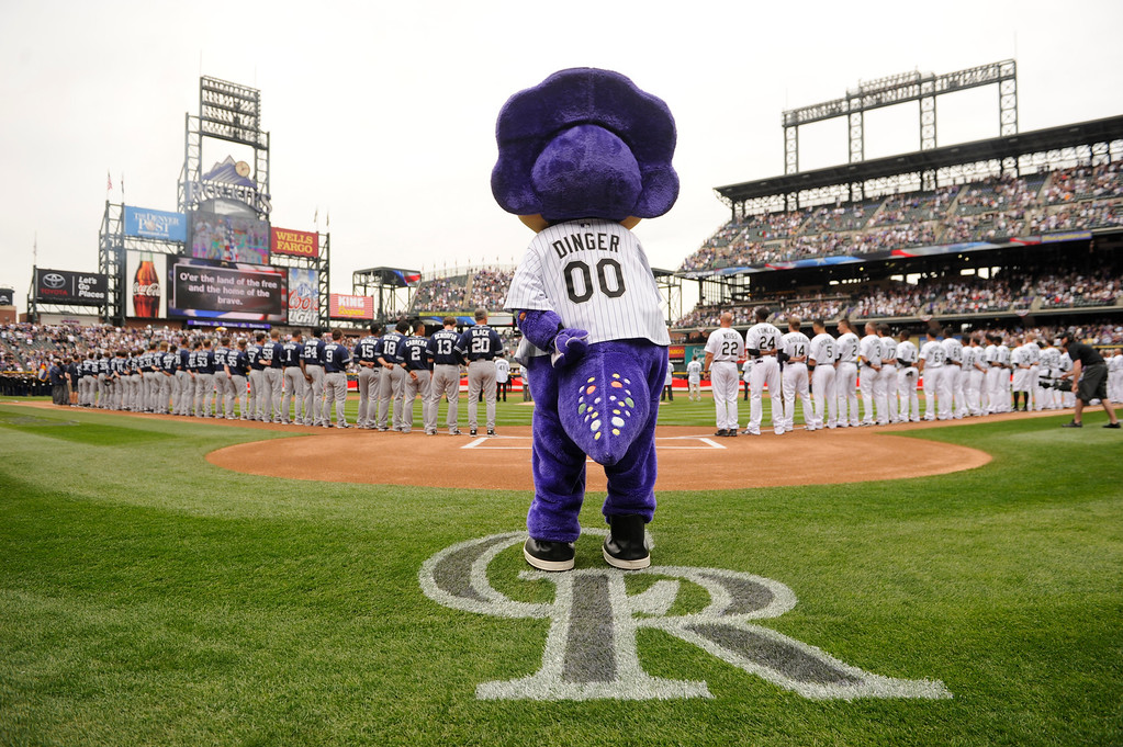 . Dinger, the Colorado Rockies mascot stands for the National Anthem before the game. (Photo by Karl Gehring/The Denver Post)