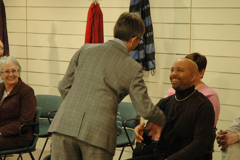 Kristi Bangert, Executive Director for ELCA Communication Services, greets a participant.